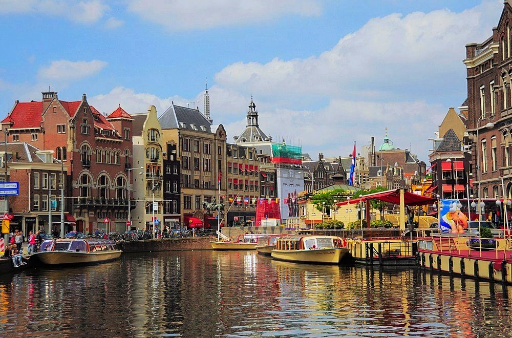 Colourful buildings of Amsterdam overlooking the canal​