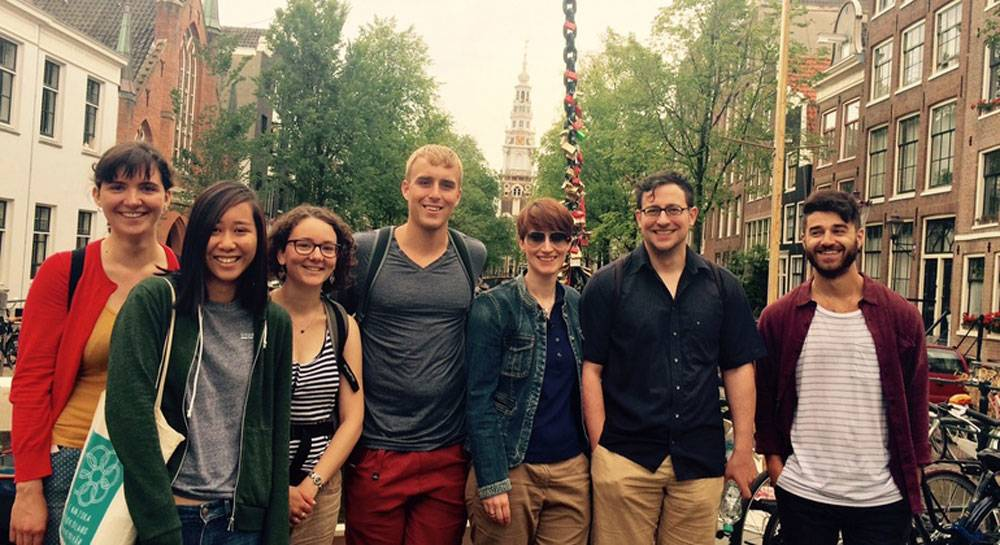 Group of people on free walking tour of Red Light District in Amsterdam​