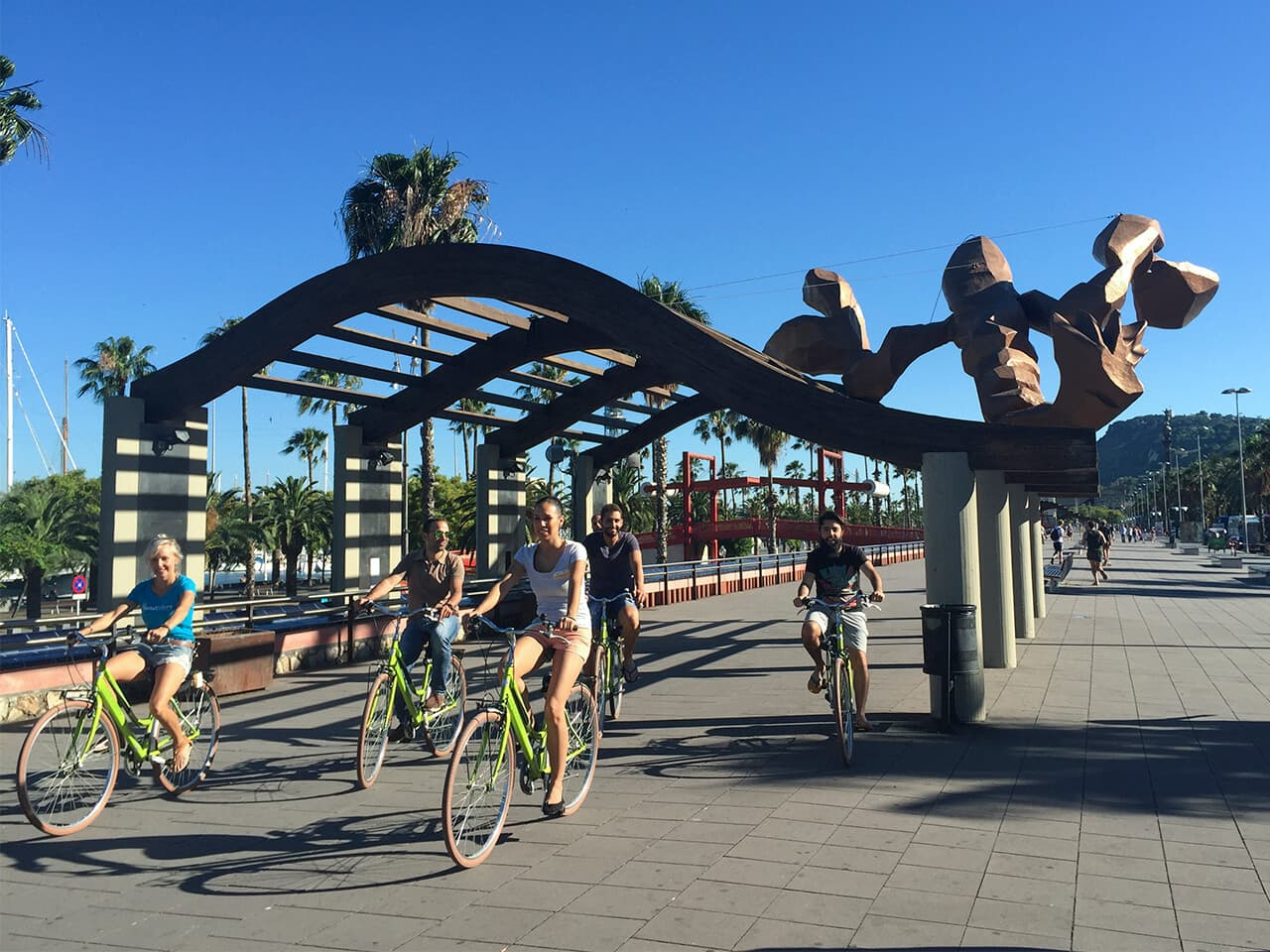 Visitors explore Barcelona by bike with their expert guide