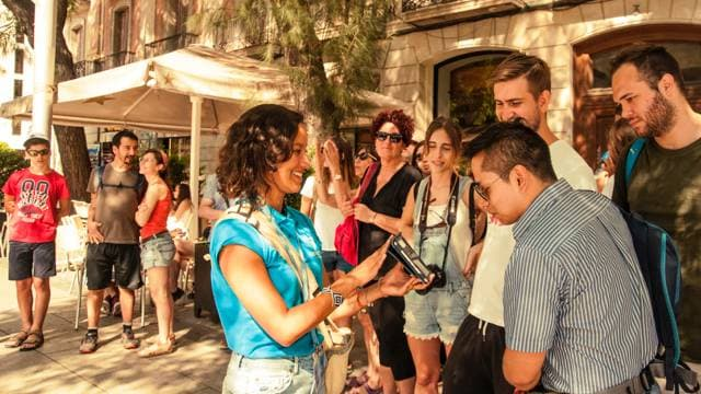 Barcelona free tour guide sharing insights to local culture