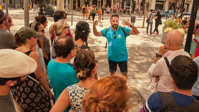 Barcelona tour guide introducing visitors to Barcelona's modernist history