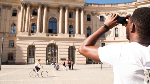 A participant captures the sight of Humboldt University on our Free tour of Berlin