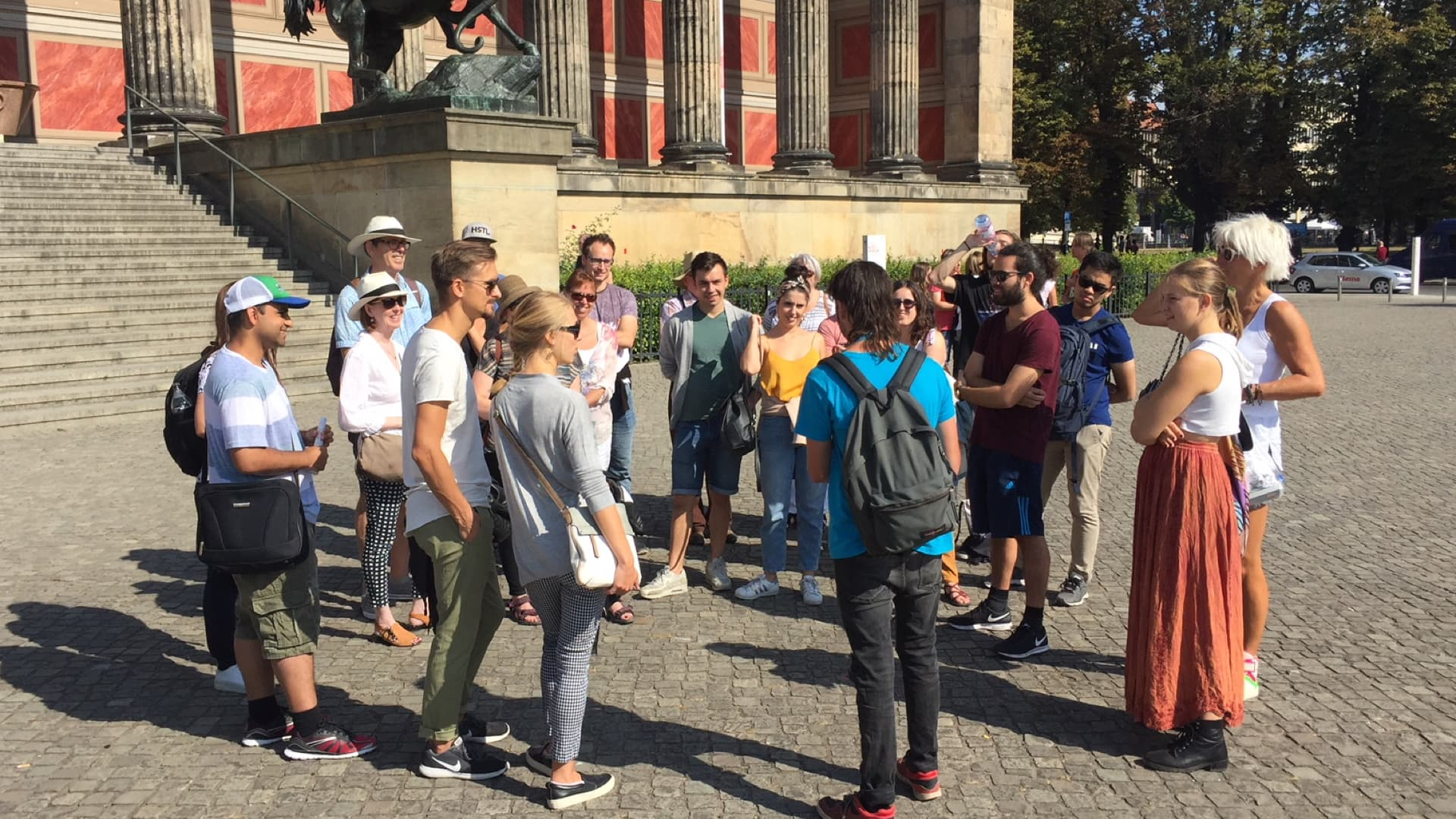 Tourists and guide of Cold War tour in Berlin