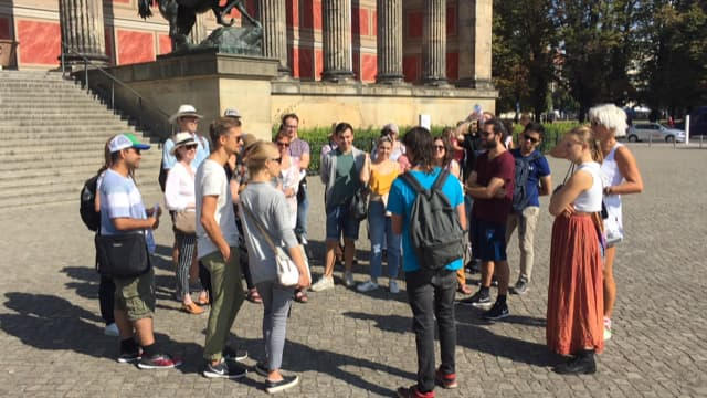 Travellers and guide starting their tour of the Cold War era
