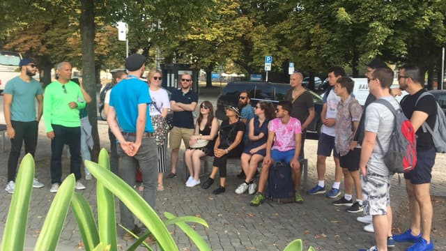 Travellers listen to their expert local guide on the free Berlin Cold War tour
