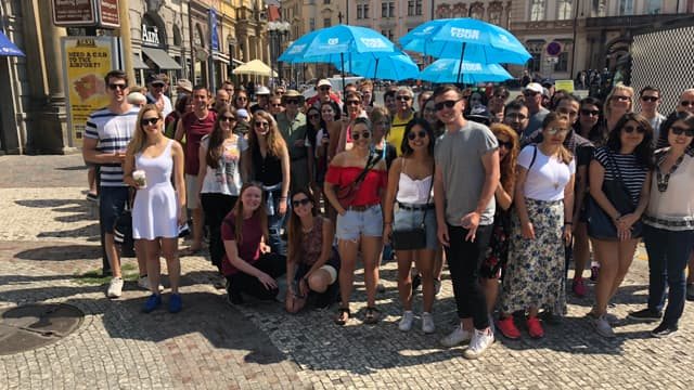 Smiling group of travellers about to do free tours of Prague's New town